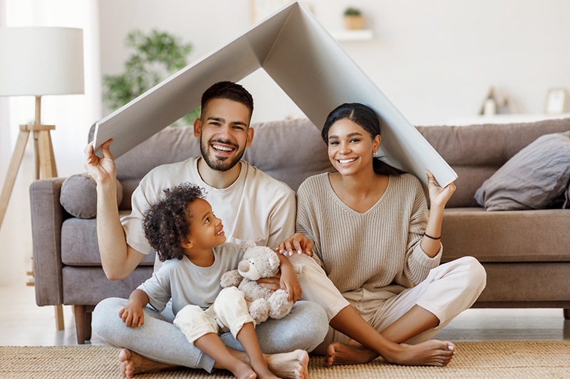 Happy family of three in the new house after a home inspection