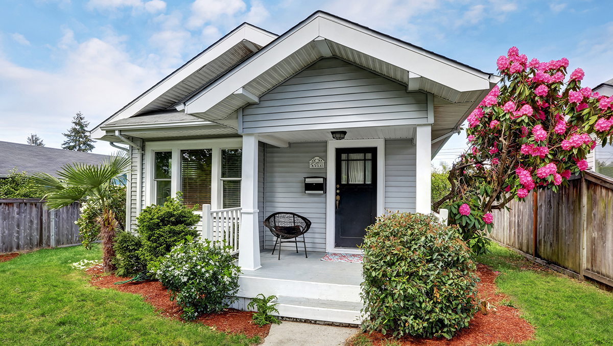 The exterior of a small, craftsman California bungalow house during a home inspection